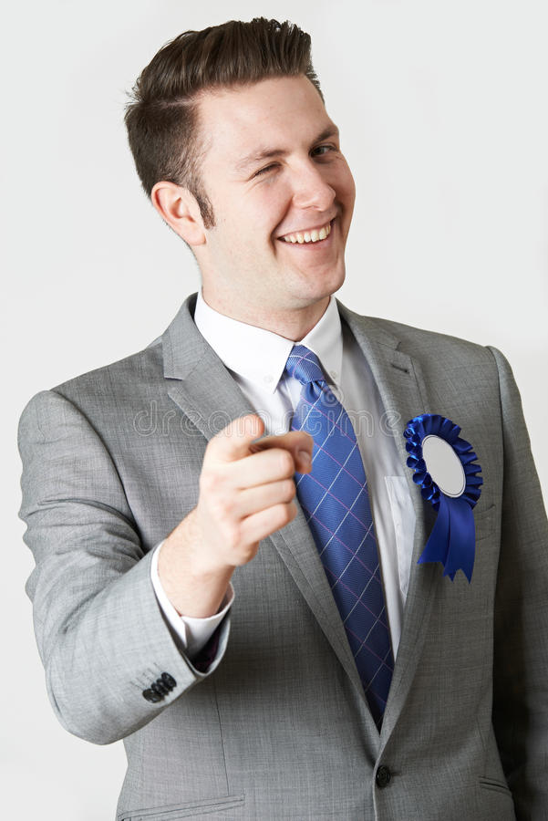 studio-portrait-untrustworthy-politician-winking-camera-55361155
