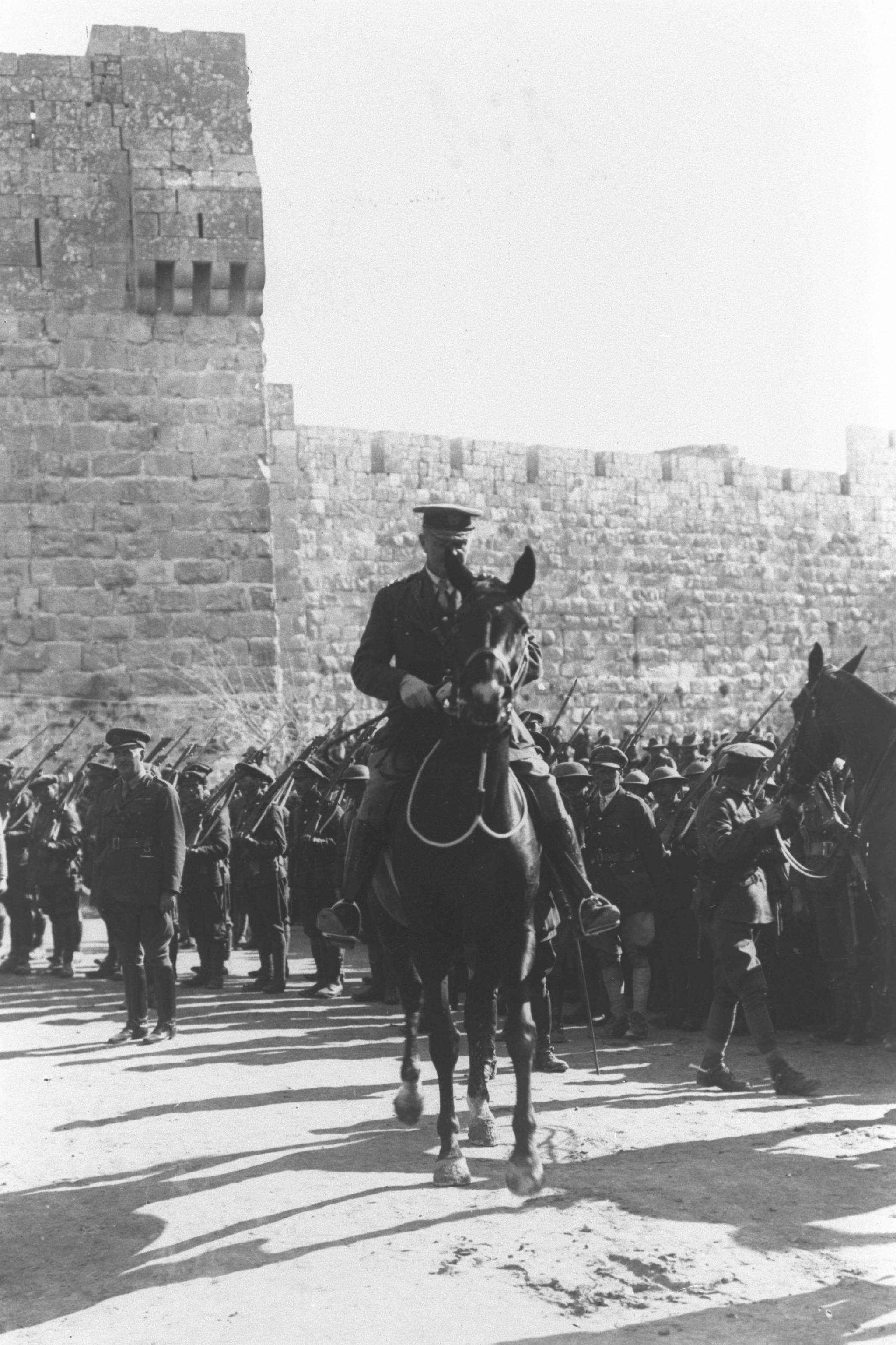 gen._edmund_hynman_allenby2c_the_commander_of_british_forces_in_palestine_during_world_war_i2c_riding_his_horse_alongside_the_walls_of_the_old_city_of_j